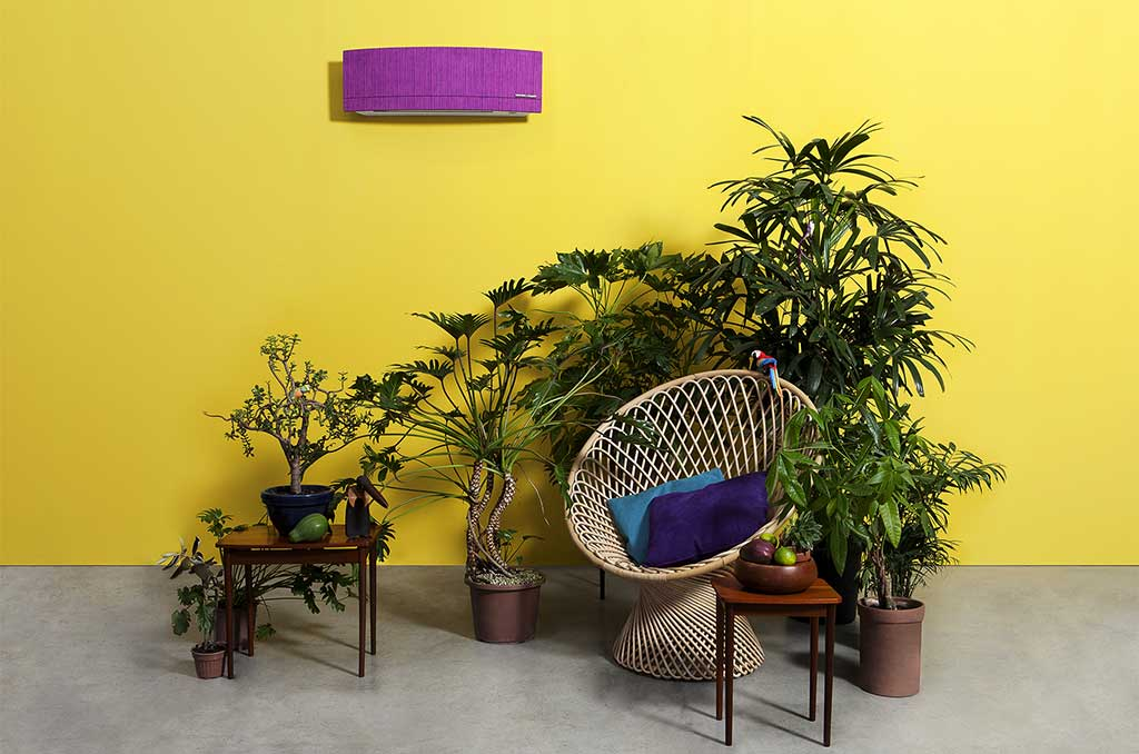 condizionatore aria rivestito in alcanatara colorato su parete gialla