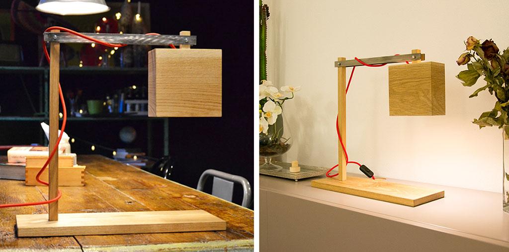 lampada da tavolo in legno appoggiata su mobile