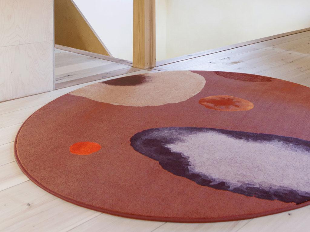 tappeto tondo rosso terra