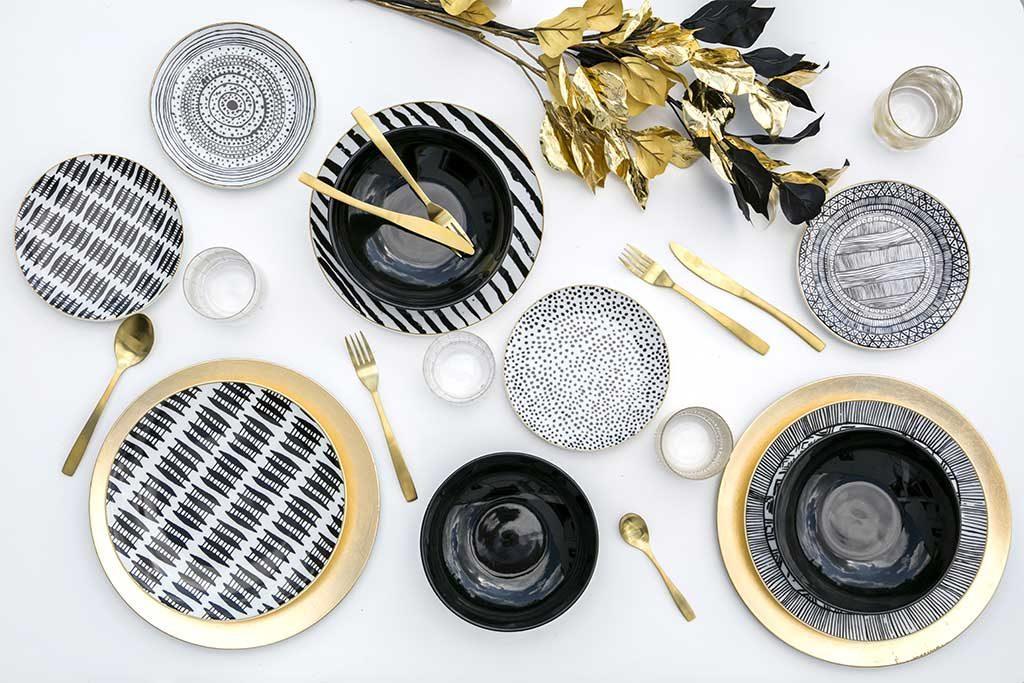 servizio piatti nero oro bianco