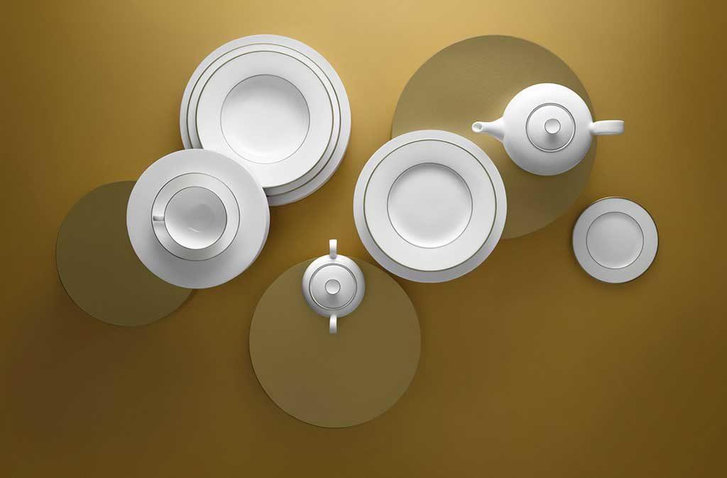 servizio piatti bianco bordo oro