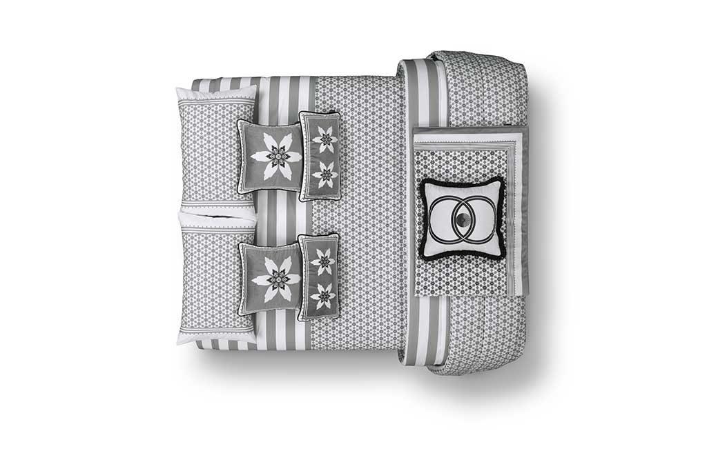 biancheria letto grigio bianco