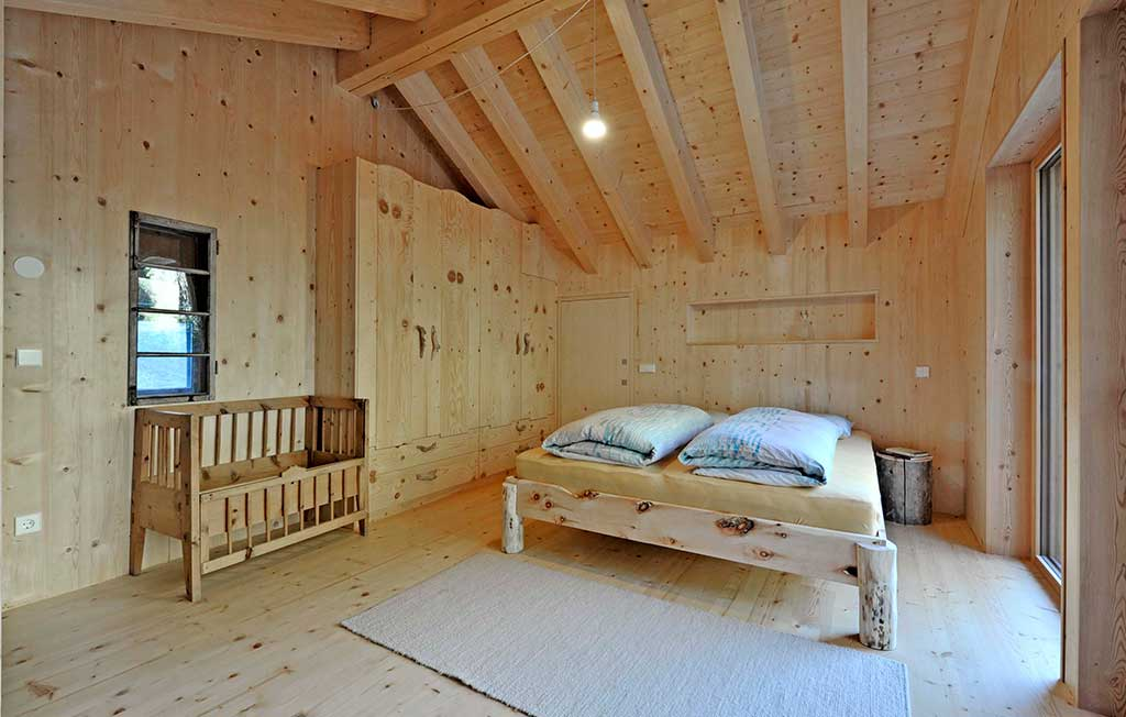 casa vacanze legno camera letto