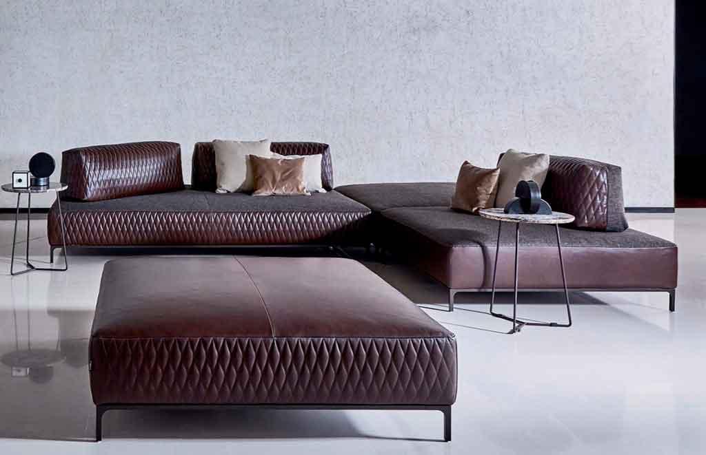 divano angolare pelle e tessuto