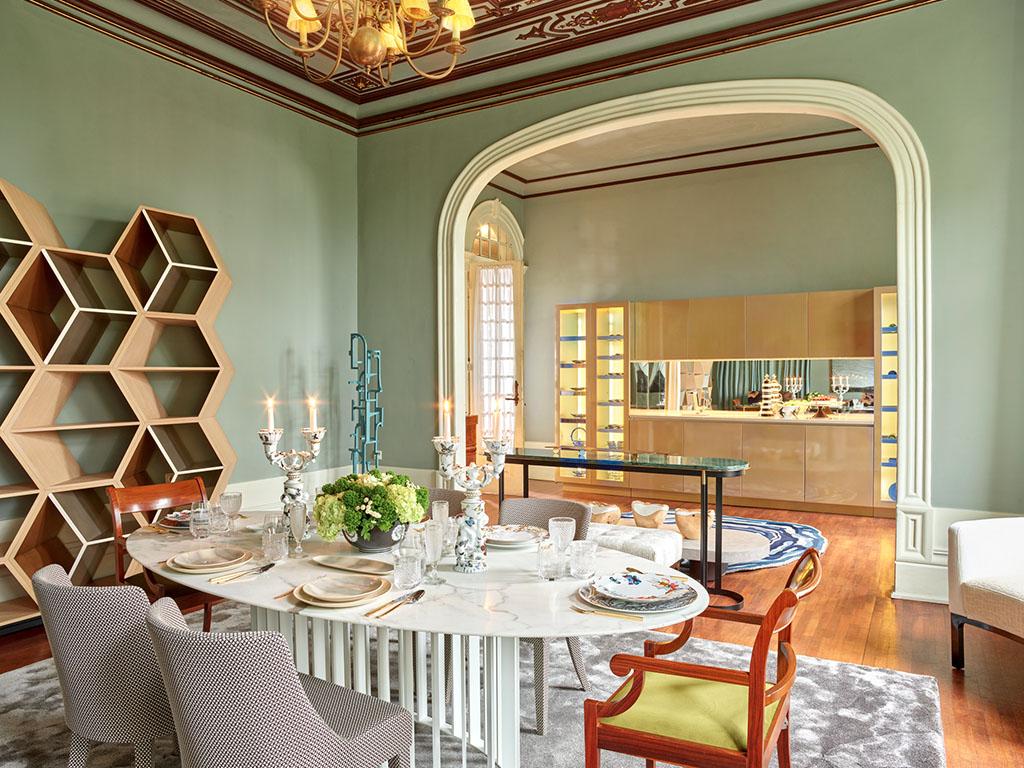allestimento sala da pranzo pareti verdi